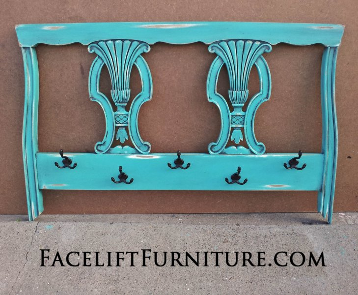 Twin headboard repurposed into coat rack. In distressed Turqouise with Black Glaze. From Facelift Furniture's Repurposed Wall Pieces Collection.