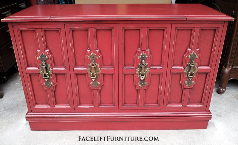 Barn Red Vintage Stereo Cabinet with Black Glaze and light distressing. Original pulls. From Facelift Furniture's Red Refinished Furniture collection.