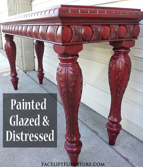 Ornate sofa table in distressed Barn Red with Black Glaze. From Facelift Furniture's Red Refinished Furniture collection.