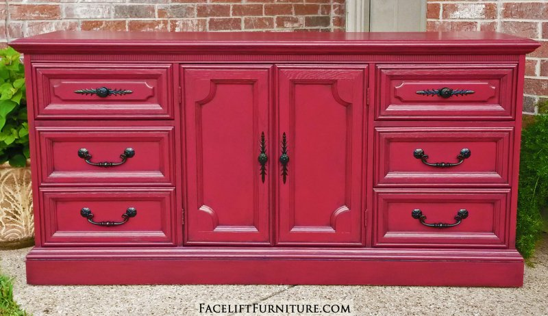 Vintage Dresser upstyled in Barn Red with Black Glaze accenting detailed areas. Original pulls spray painted black. From Facelift Furniture's Red Refinished Furniture collection.