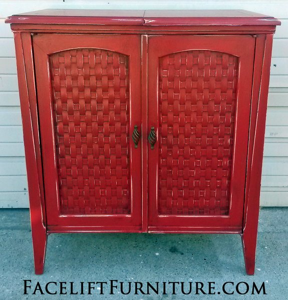 Sewing Cabinet in Barn Red with Black Glaze. Distressing reveals white primer. From Facelift Furniture's Red Refinished Furniture collection.