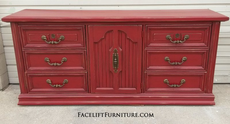 Large Dresser in distressed Chili Pepper Red with Black Glaze. Original pulls. From Facelift Furniture's Red Refinished Furniture collection.