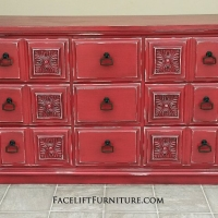Ornate Dresser in distressed Barn Red with Black Glaze. Distressing reveals white primer. New pulls. From Facelift Furniture's Red Refinished Furniture collection.