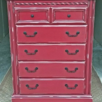 Tall Chest of Drawers in Barn Red with Black Glaze. Distressing reveals white primer. Original pulls painted Black. From Facelift Furniture's Red Refinished Furniture collection.