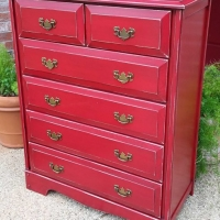 Chest of Drawers in distressed Barn Red. Black Glaze accents molding and highlights oak wood grain. From Facelift Furniture's Red Refinished Furniture collection.