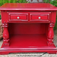 Chunky end table in Barn Red with Black Glaze accenting detail. Distressing reveals white primer and original wood tones. From Facelift Furniture's Red Refinished Furniture collection.