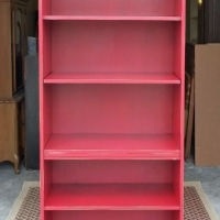 Large Bookshelf Cabinet in distressed Barn Red with Black Glaze. Middle shelf adjustable. From Facelift Furniture's Red Refinished Furniture collection.