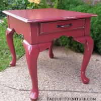Queen Anne End Table in Barn Red with Black Glaze. Distressing reveals white primer and original woods tones. New drawer pull.  From Facelift Furniture's Red Refinished Furniture collection.