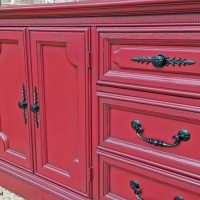 Vintage Dresser upstyled in Barn Red with Black Glaze accenting detailed areas. Original pulls spray painted blackVintage Dresser upstyled in Barn Red with Black Glaze accenting detailed areas. Original pulls spray painted black. From Facelift Furniture's Red Refinished Furniture collection.