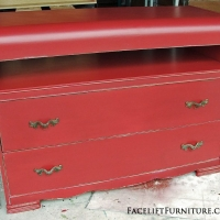 Waterfall dresser repurposed into media stand. In distressed Red with Black Glaze. From Facelift Furniture's Red Refinished Furniture collection.