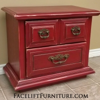 Nightstand in Chili Pepper Red and Black Glaze, with distressing revealing white primer. Lots of character and pop with this piece. From Facelift Furniture's Red Refinished Furniture collection.
