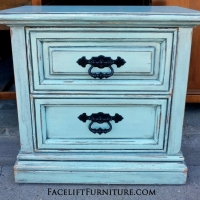 Nightstand in distressed Robin's Egg Blue with Black Glaze.  Original pulls painted black. From Facelift Furniture's Robin's Egg Blue Furniture collection.