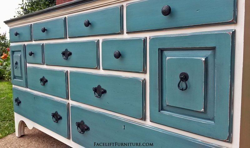 Large Dresser in Off White, with Black Top and Sea Blue drawers. Glazed Black, with distressing revealing white primer and original woods tones. Original pulls painted Black. From Facelift Furniture's Sea Blue Furniture collection.