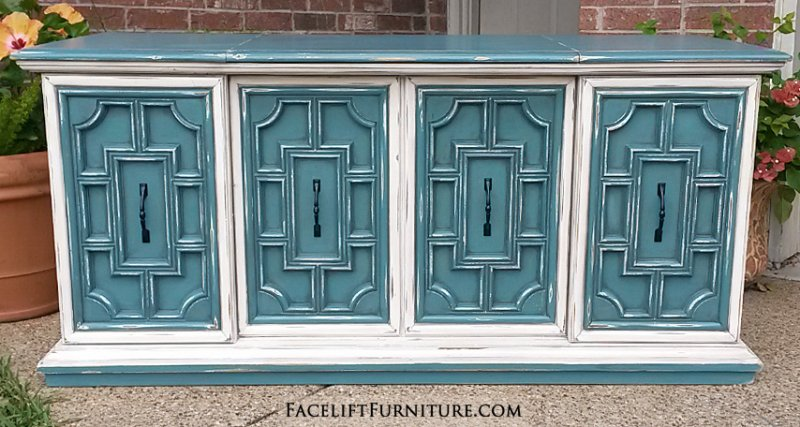 Vintage Stereo Cabinet in distressed Sea Blue & Off White with Black Glaze. Side doors slide to middle, and top opens up to large storage space created by removing stereo components and speakers. A great option for a flat screen TV. From Facelift Furniture's Sea Blue Furniture collection.