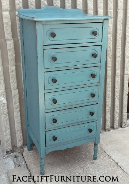 Narrow Chest of Drawers in distressed Sea Blue with Black Glaze. New knobs. From Facelift Furniture's Sea Blue Furniture collection.