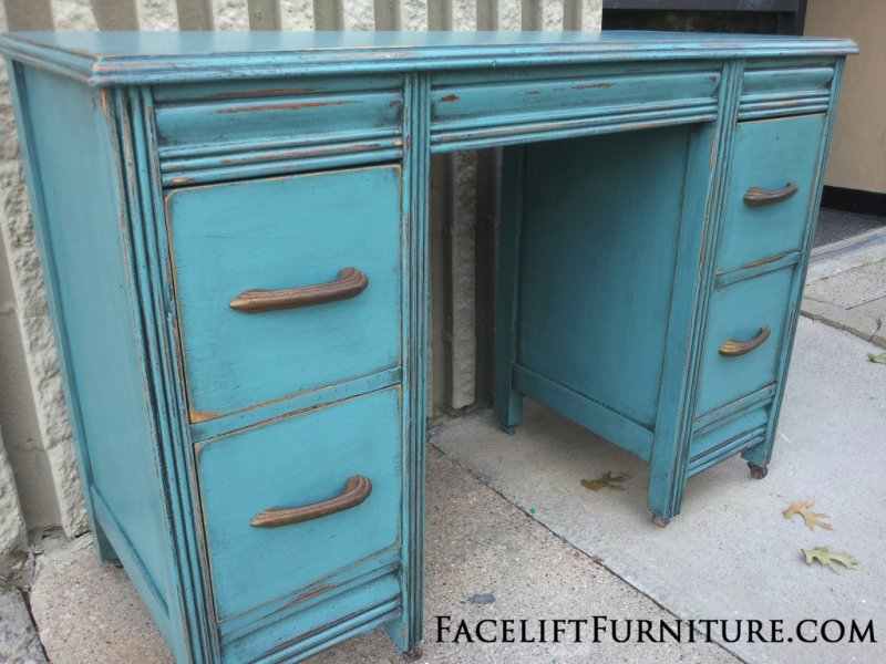 Vanity Desk in distressed Sea Blue with Black Glaze. Original drawer pulls. From Facelift Furniture's Sea Blue Furniture collection.
