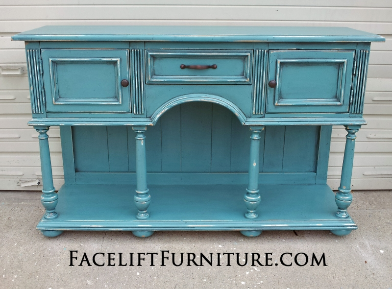 Buffet Repurposed into Media Console, in Sea Blue and Black Glaze. Distressing revealing white primer. From Facelift Furniture's Sea Blue Furniture collection.