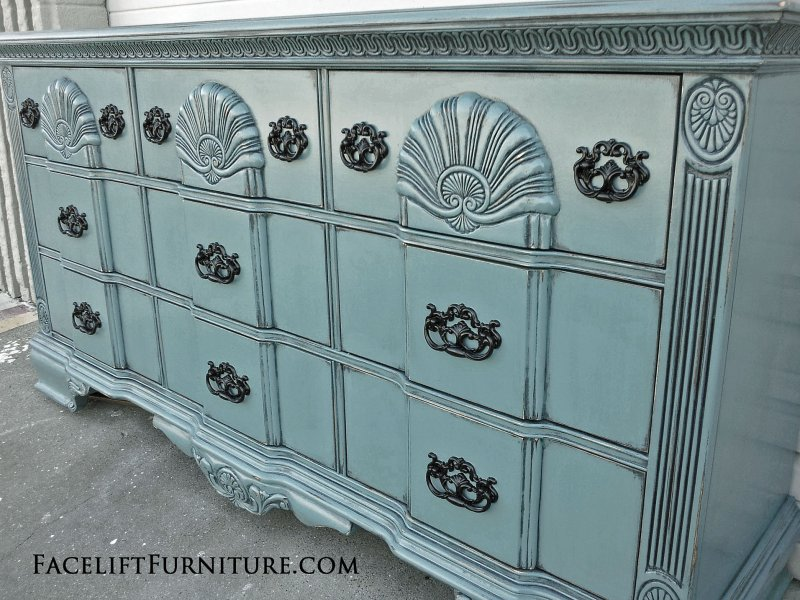 Ornate Dresser in distressed Sea Blue, with Black Glaze and pulls painted Black. Repurposed as a media console. From Facelift Furniture's Sea Blue Furniture collection.