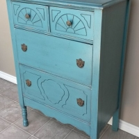 Antique Chest in distressed Sea Blue with Black Glaze. Original pulls. From Facelift Furniture's Sea Blue Furniture collection.
