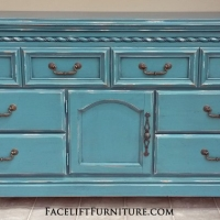 Tall Dresser in distressed Sea Blue with Black Glaze. Original pulls. 8 drawers, with 2 behind door. From Facelift Furniture's Sea Blue Furniture collection.