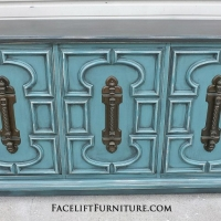Sea Blue Vintage Cabinet with Black Glaze.  Distressing reveals heavy white primer.  Original pulls. From Facelift Furniture's Sea Blue Furniture collection.