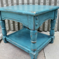 Chunky end table upstyled in distressed Sea Blue and Black Glaze. From Facelift Furniture's Sea Blue Furniture collection.