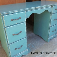 Sea Blue Vanity Desk, with Black Glaze. Distressing reveals white primer. New hardware. From Facelift Furniture's Sea Blue Furniture collection.