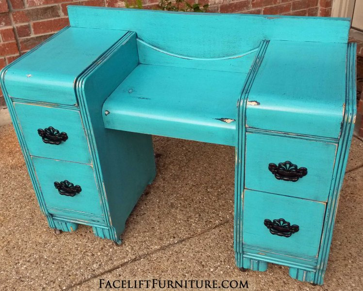 Distressed Turquoise Vanity with heavy Black Glaze. Vintage pulls painted black. From Facelift Furniture's Turquoise Refinished Furniture collection.