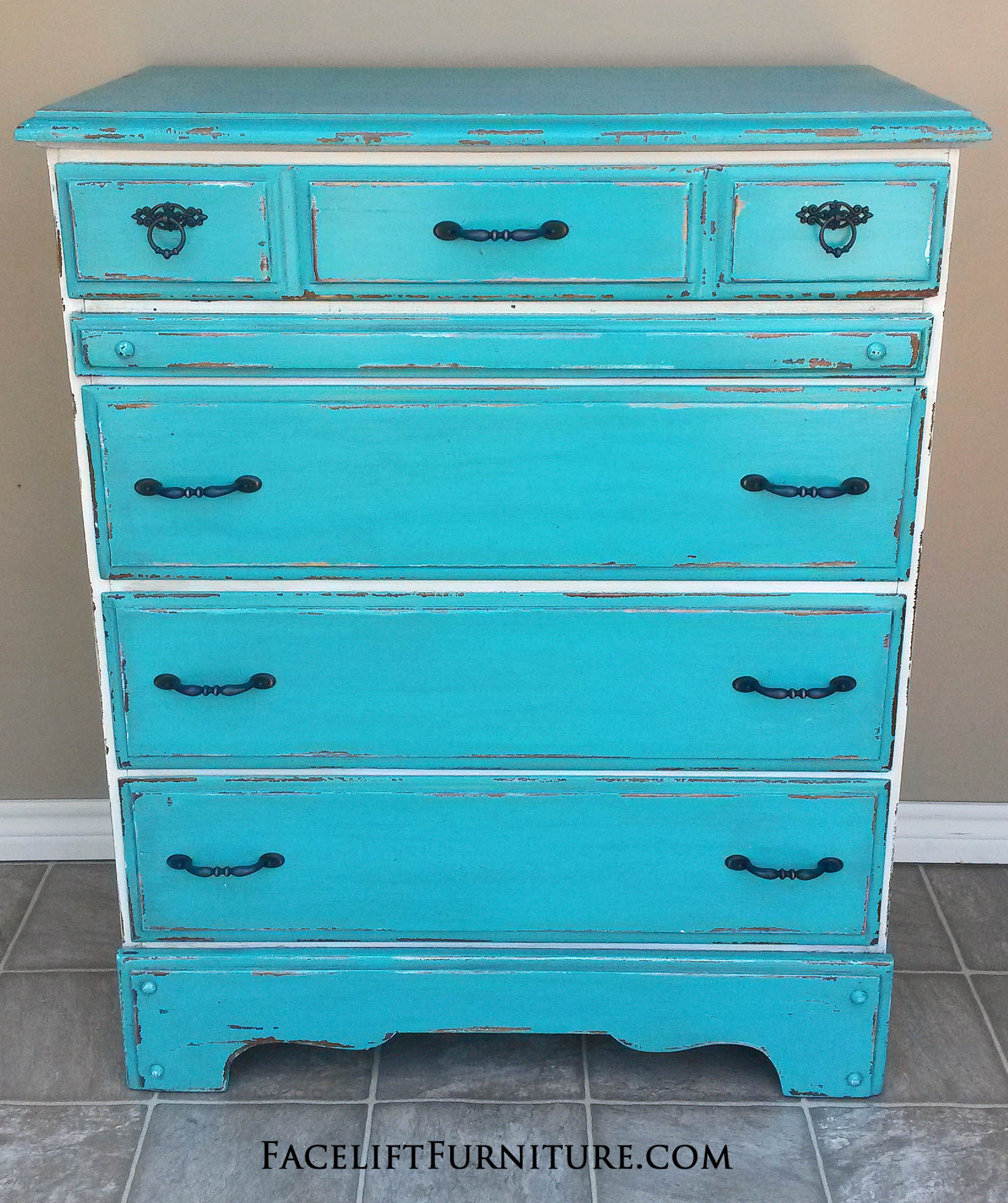 Turquoise and Antiqued White Chest of Drawers with Espresso Glaze. Heavy chippy distressing. New oil rubbed bronze pulls. From Facelift Furniture's Turquoise Refinished Furniture collection.