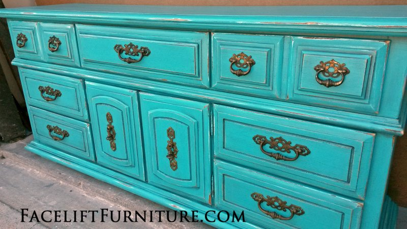 Large Dresser in distressed Turquoise with Black Glaze. Original hardware. From Facelift Furniture's Turquoise Refinished Furniture collection.