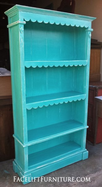 Ornate handmade bookshelf in Turquoise with white glaze. From Facelift Furniture's Turquoise Refinished Furniture collection.