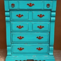 Tall Chunky Chest of Drawers in distressed Turquoise with Black Glaze. Pulls painted Paprika! From Facelift Furniture's Turquoise Refinished Furniture collection.