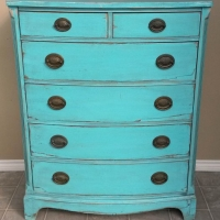 Rustic Vintage Dresser in heavily distressed Turquoise with Black Glaze. Rustic look enhanced by areas with missing veneer. From Facelift Furniture's Turquoise Refinished Furniture collection.