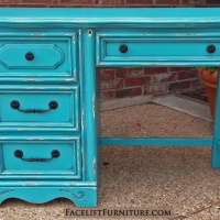 Chunky Desk in distressed Turquoise with Black Glaze. Original pulls and knobs painted black. From Facelift Furniture's Turquoise Refinished Furniture collection.