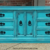 Turquoise Dresser with Black Glaze. Distressing reveals white primer and wood tones. Original ornate pulls painted black. 9 drawers total. From Facelift Furniture's Turquoise Refinished Furniture collection.