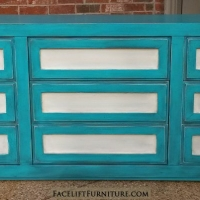 Dresser in distressed Turquoise and Off White, with Black Glaze. Nine drawers, with upper molding serving as pulls. From Facelift Furniture's Turquoise Refinished Furniture collection.