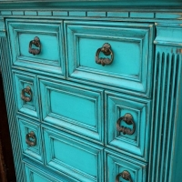 Chunky Chest of Drawers in distressed Turquoise, with heavy Black Glaze accenting detailed areas. From Facelift Furniture's Turquoise Refinished Furniture collection.