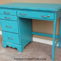 Distressed Turquoise Desk with Black Glaze. New brushed silver pulls. From Facelift Furniture's Turquoise Refinished Furniture collection.