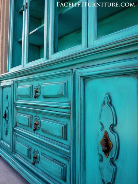 Vintage China Cabinet in Turquoise with Black Glaze. Original pulls. From Facelift Furniture's Turquoise Refinished Furniture collection.