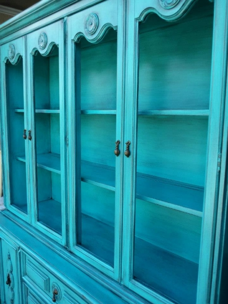 Large china cabinet upstyled in Turquoise and heavy Black Glaze.