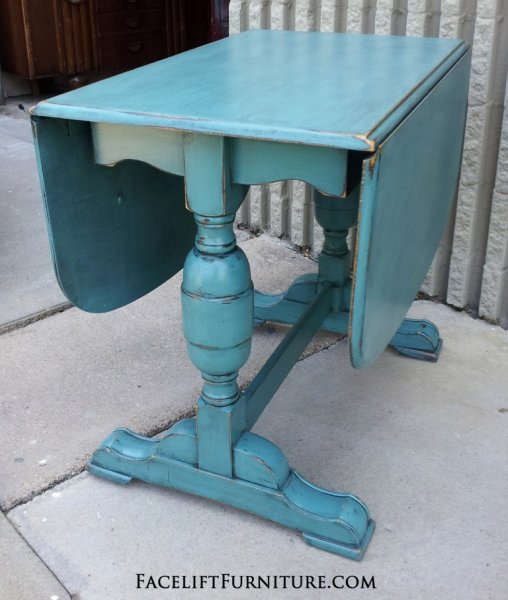 Antique chunky drop leaf table in distressed Sea Blue with Black Glaze.