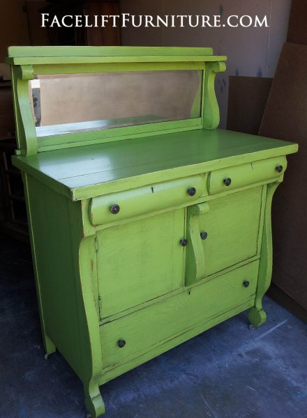 Antique Buffet in distressed Lime Green with Black Glaze. Re-purposed as a baby changing table. From Facelift Furniture's DIY Inspiration album.