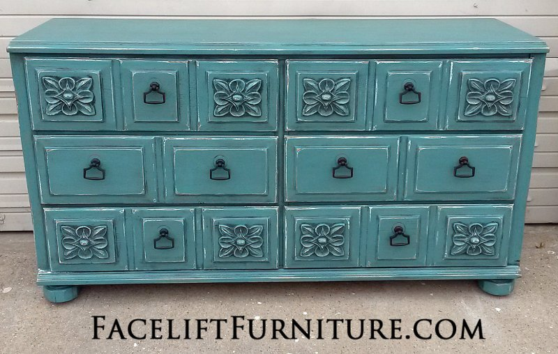 Dresser with Ornate Drawers in distressed Sea Blue and Black Glaze, with new pulls. From Facelift Furniture's DIY Inspiration album.
