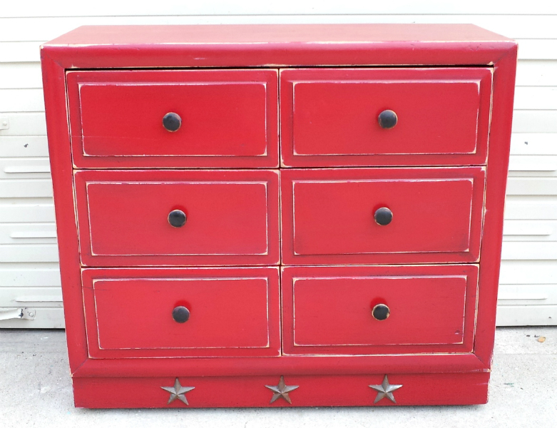 Dresser in distressed Barn Red, with Black Glaze. From Facelift Furniture's DIY Inspiration album.