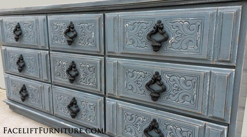Ornate Dresser in Slate Blue with Black Glaze, distressed down to white primer. Original pulls painted black. From Facelift Furniture's DIY Inspiration album.
