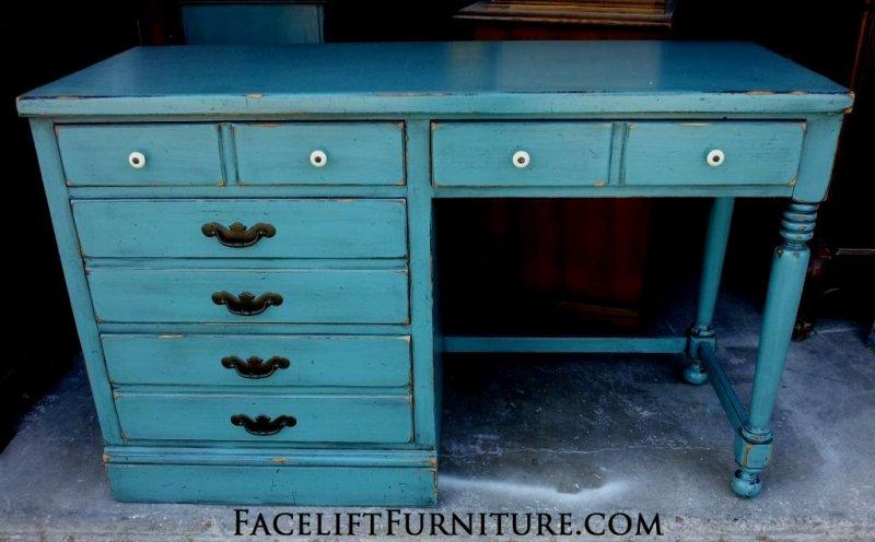 Ethan Allen desk in distressed Sea Blue with Black Glaze. Original pulls. From Facelift Furniture's DIY Inspiration album.