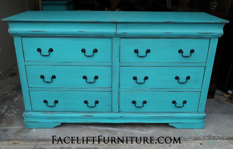 Large Dresser in Turquoise with Black Glaze.  Original hardware painted black. From Facelift Furniture's DIY Inspiration album.