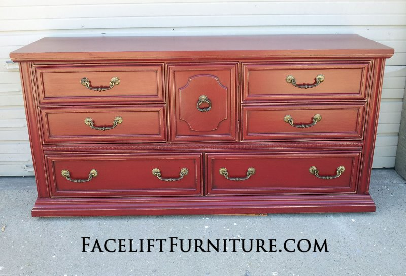 Large Dresser in distressed Chili Pepper Red with Black Glaze. Original pulls. From Facelift Furniture's DIY Inspiration album.