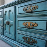 Large chunky dresser, with enormous old pulls, upstyled in distressed Sea Blue and Black Glaze.