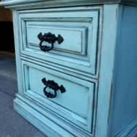 Chunky nightstand in Robin's Egg Blue and Black Glaze, with distressing revealing white primer.  Original hardware painted black.